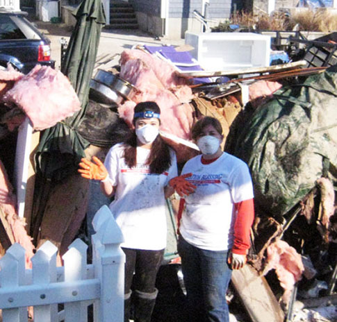 Quinn Emanuel's attorneys and staff volunteered to clean up the homes of hurricane victims and set up a collection center for people to donate essentials to the cause after Hurricane Sandy.