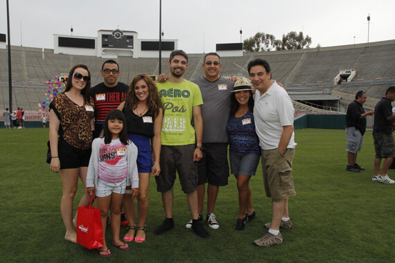 Quinn Emanuel's clients, staff, attorneys and summer associates enjoying rides, bungee jumping, rock walls, game booths and psychics at our annual Rose Bowl Party.